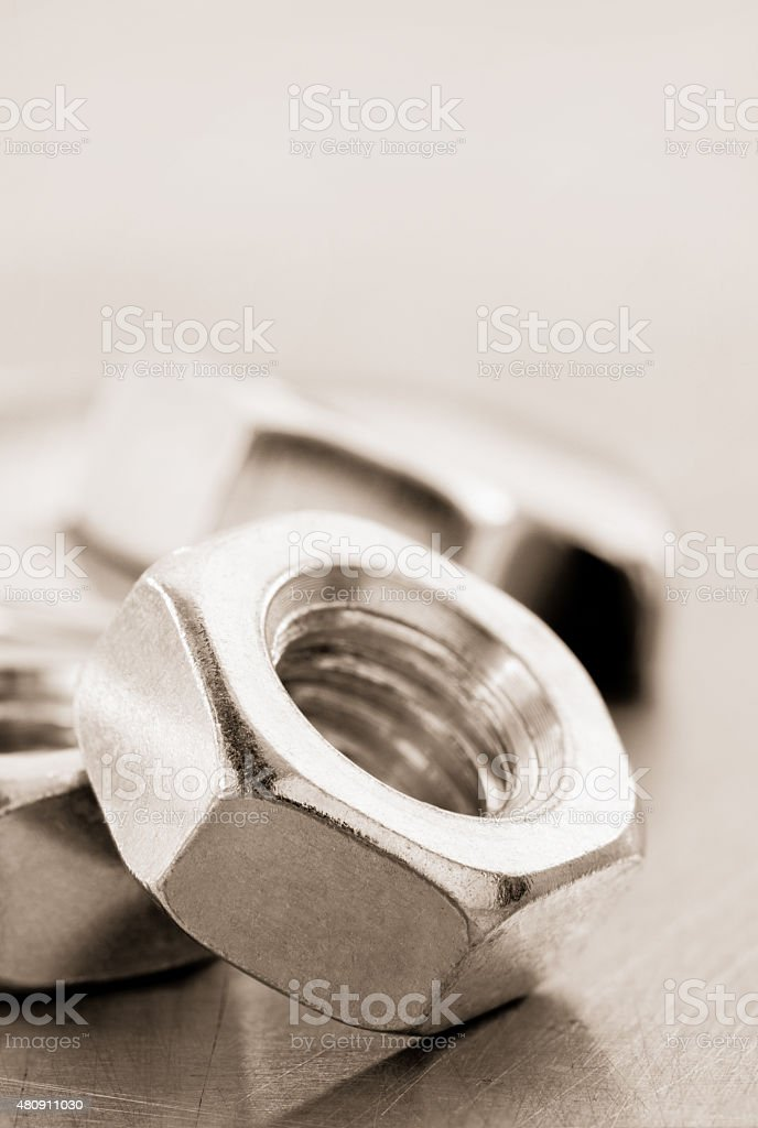 nuts tool at metal background stock photo