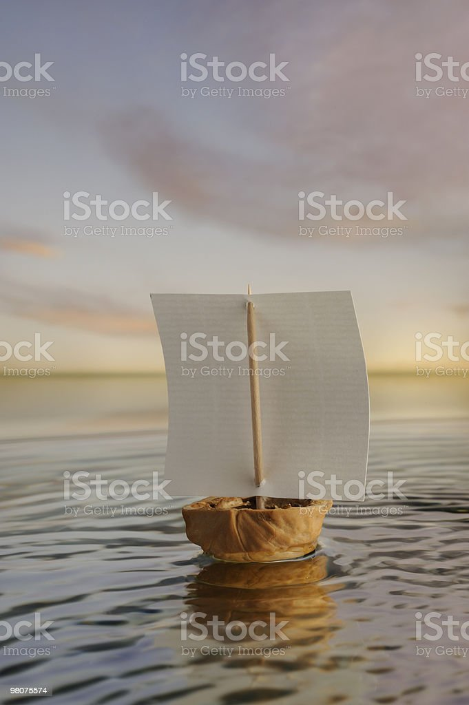 Nutschell boat sailing before the wind . royalty-free stock photo