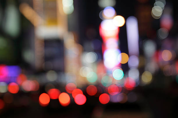 ny times square - defocused light dots multi colored stock photo