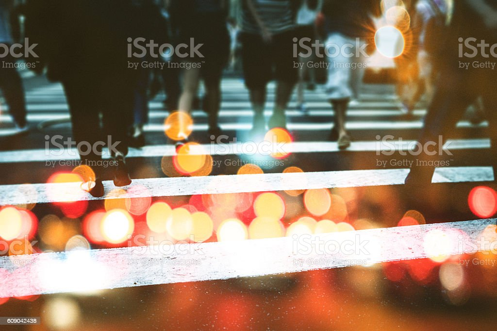 nyc commuters crossing the street in double exposure stock photo