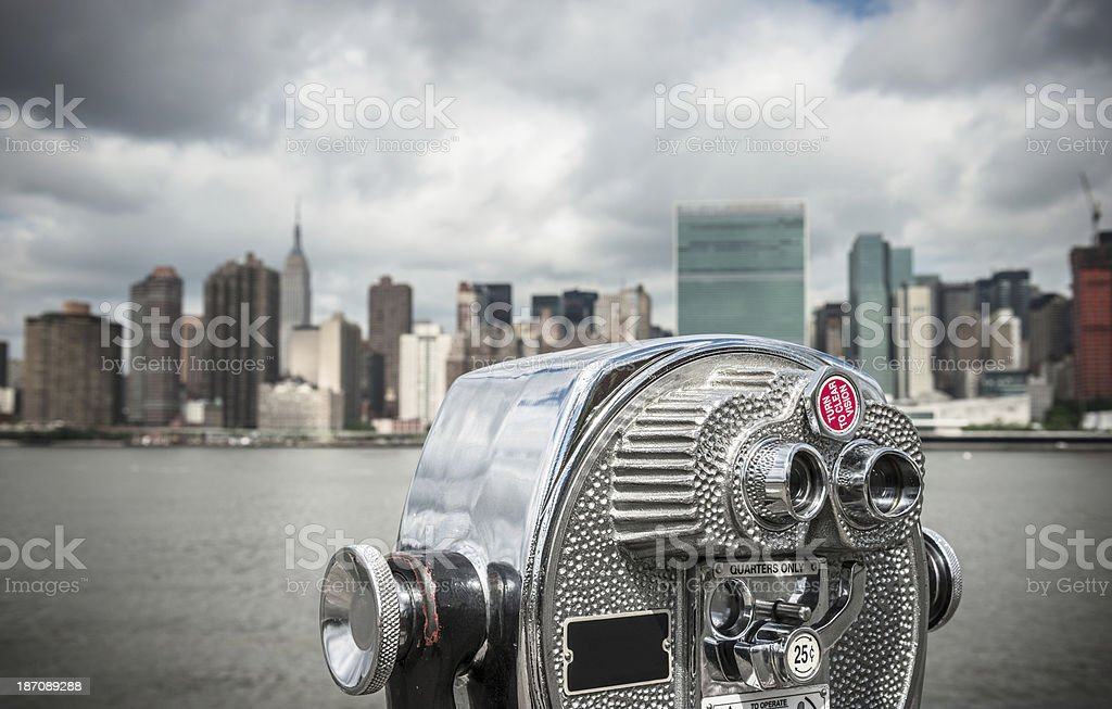 nyc skyline with binocular in the foreground royalty-free stock photo
