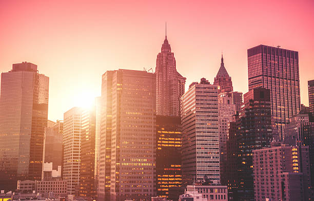 nyc skyline with tall skyscraper - pink sunrise bildbanksfoton och bilder