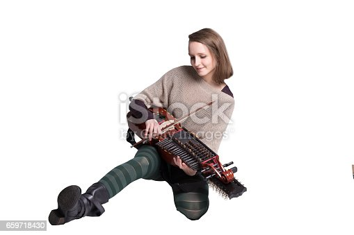 woman with medieval or baroque musical instrument isolated on white; concept of folk music player