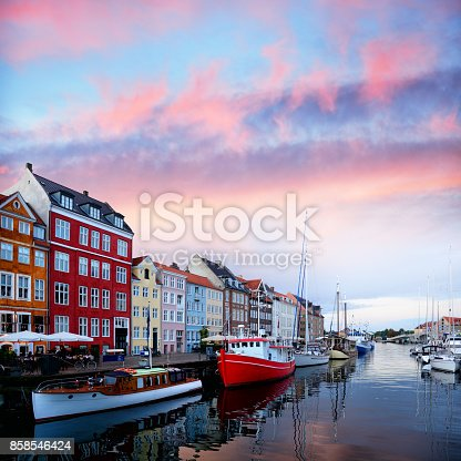 Nyhavn in Copenhagen is one of the most popular tourist places in dusk, Denmark. Composite photo
