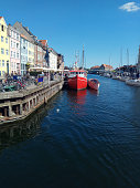 Blue sky, sunshine over wonderful Copenhagen and colorful houses along the Nyhavn canal