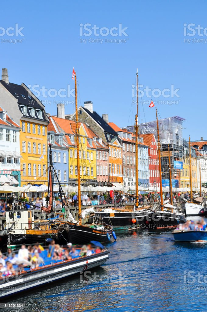 Nyhavn district is one of the most famous and beautiful landmark in Copenhagen, Denmark in a sunny day stock photo