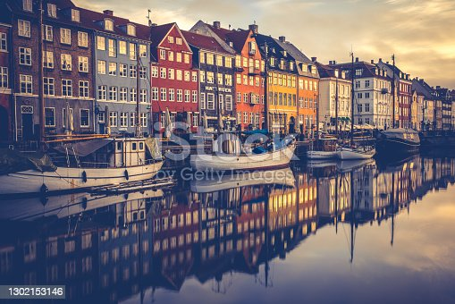 The iconic Nyhavn - a beautiful and authentic part of Copenhagen with lots of charm, cafes, canal boat trips and nightlife which attracts tourists and locals alike.