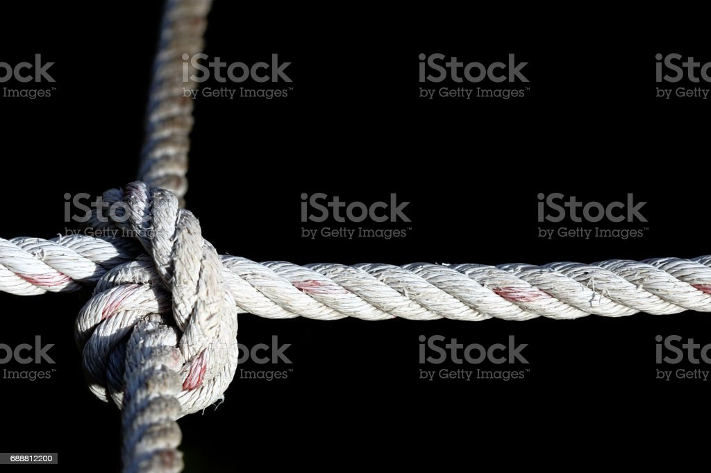 Nylon Rope Knot four ways, difficult hard to solve, black background stock photo