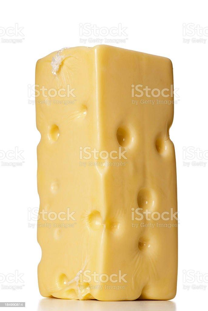 nylon wrapped swiss cheese block stock photo