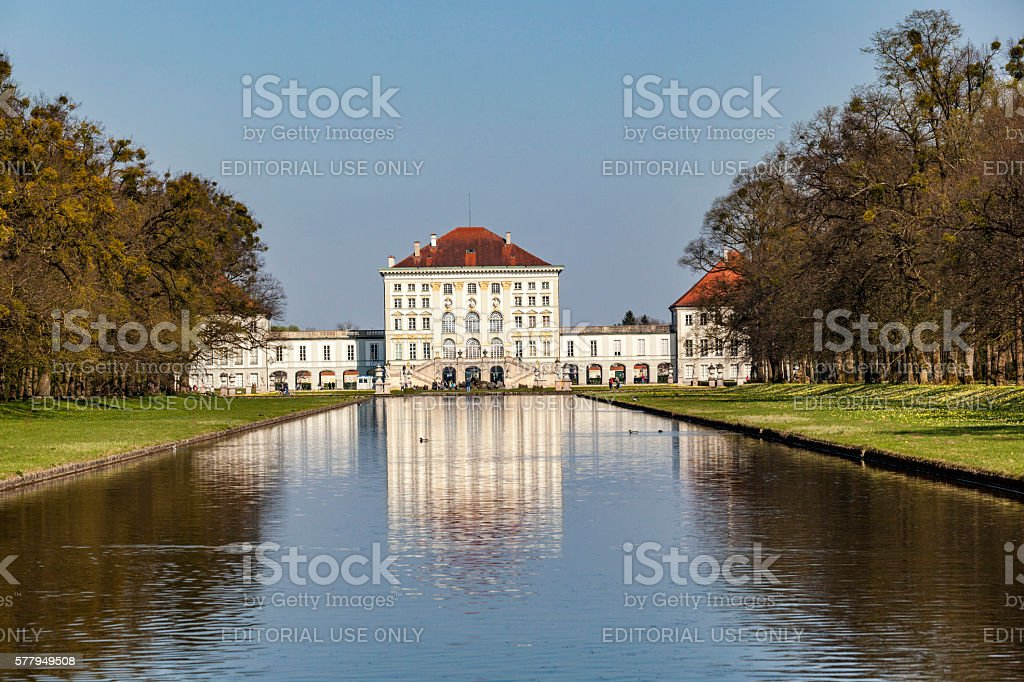 Nymphenburg castle grounds in Munich with reflection in lake stock photo