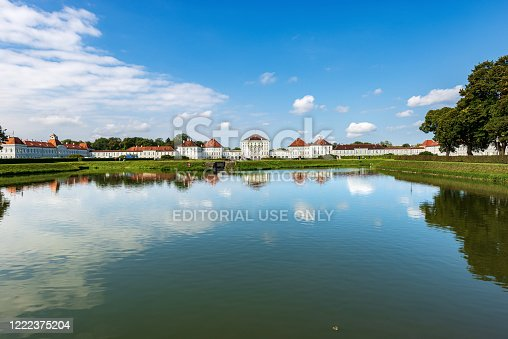 Munich, Germany - September 8th, 2018: The Nymphenburg Palace (Schloss Nymphenburg - Castle of the Nymphs) with the lake or pond. The palace was the main summer residence of the former rulers of Bavaria of the House of Wittelsbach. The palace was commissioned by the prince electoral couple Ferdinand Maria and Henriette Adelaide of Savoy to the designs of the Italian architect Agostino Barelli.