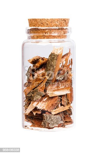 Oak bark in a bottle with cork stopper for medical use. High resolution photo.