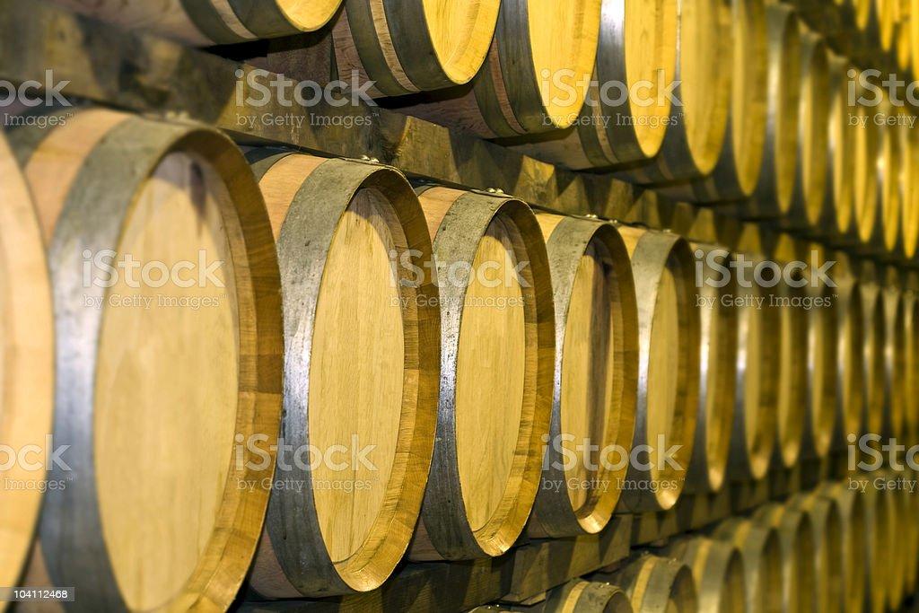 Oak barrels in a row royalty-free stock photo