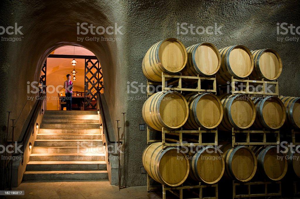 Oak barrels in wine cave at winery Napa Sonoma California royalty-free stock photo
