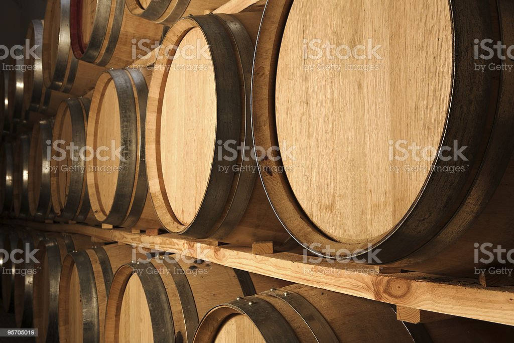 Oak barrels maturing red wine and brandy royalty-free stock photo