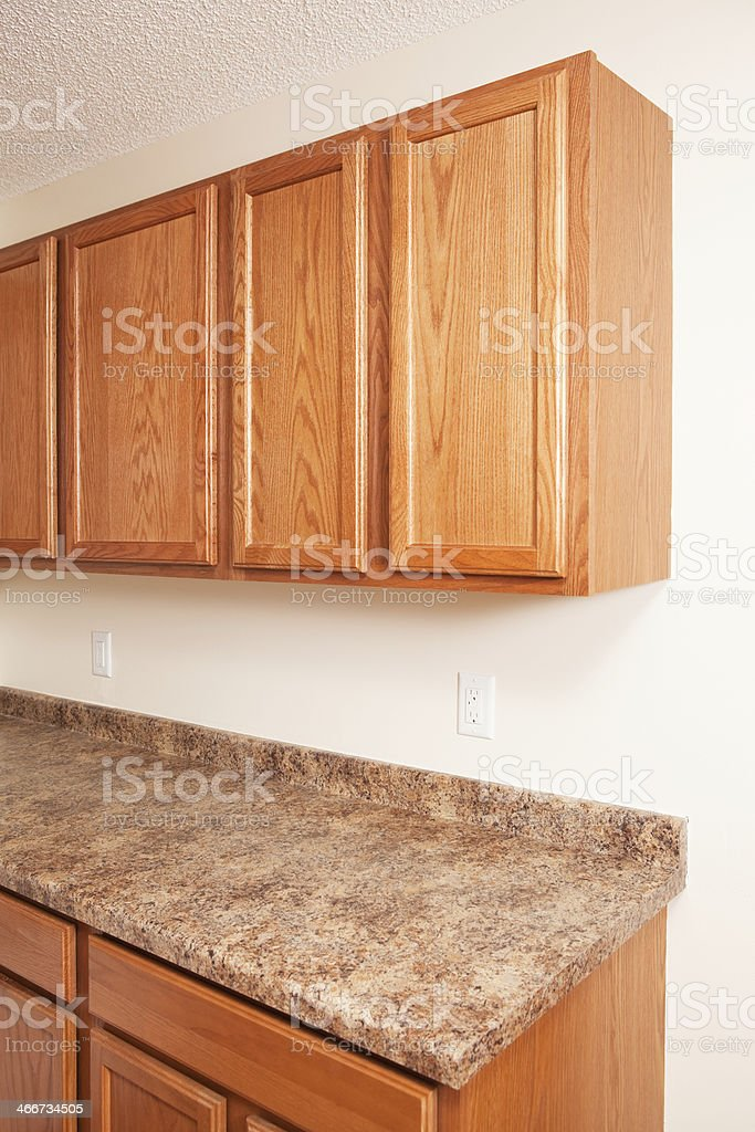 Oak Cabinets And Granite Laminate Kitchen Counter Top Stock Photo