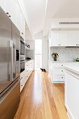 Oak flooring and white cabinetry detail in a new kitchen