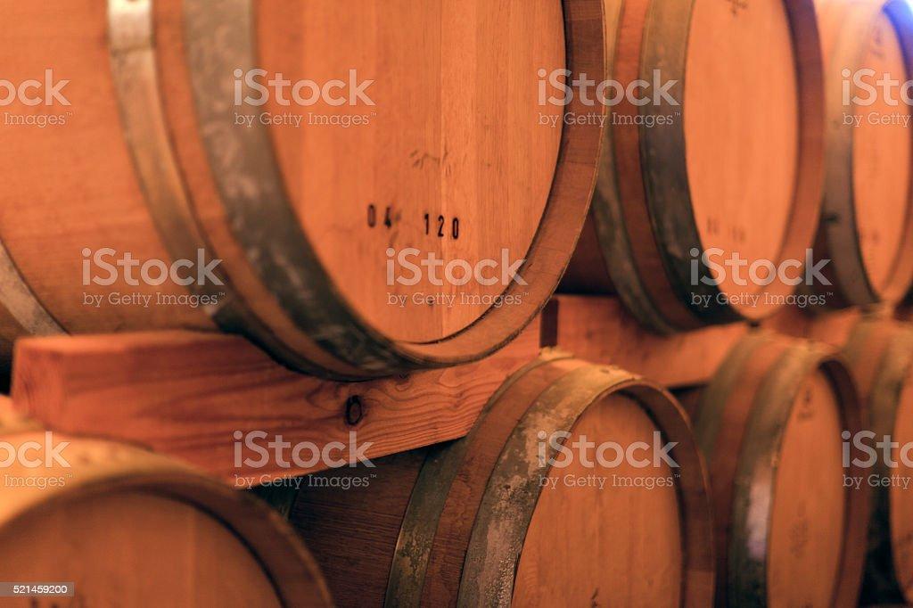 Oak tree whiskey barrels in dark cellar stock photo
