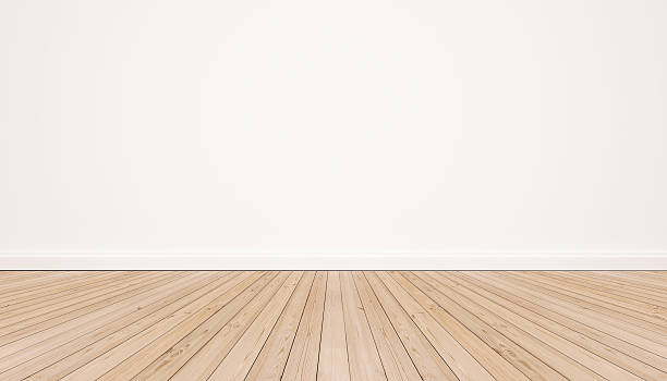 Oak wood floor with white wall stock photo