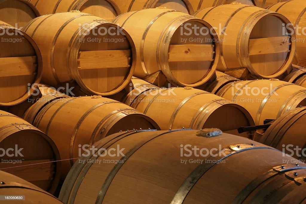 Oak Wooden Wine Barrels in Winery Aging Cellar for Winemaking royalty-free stock photo