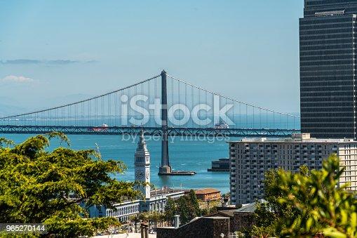Oakland Bay Bridge To San Francisco California Suspension Bridge Over The Bay Area View From Coit Tower - Stockowe zdjęcia i więcej obrazów Architektura