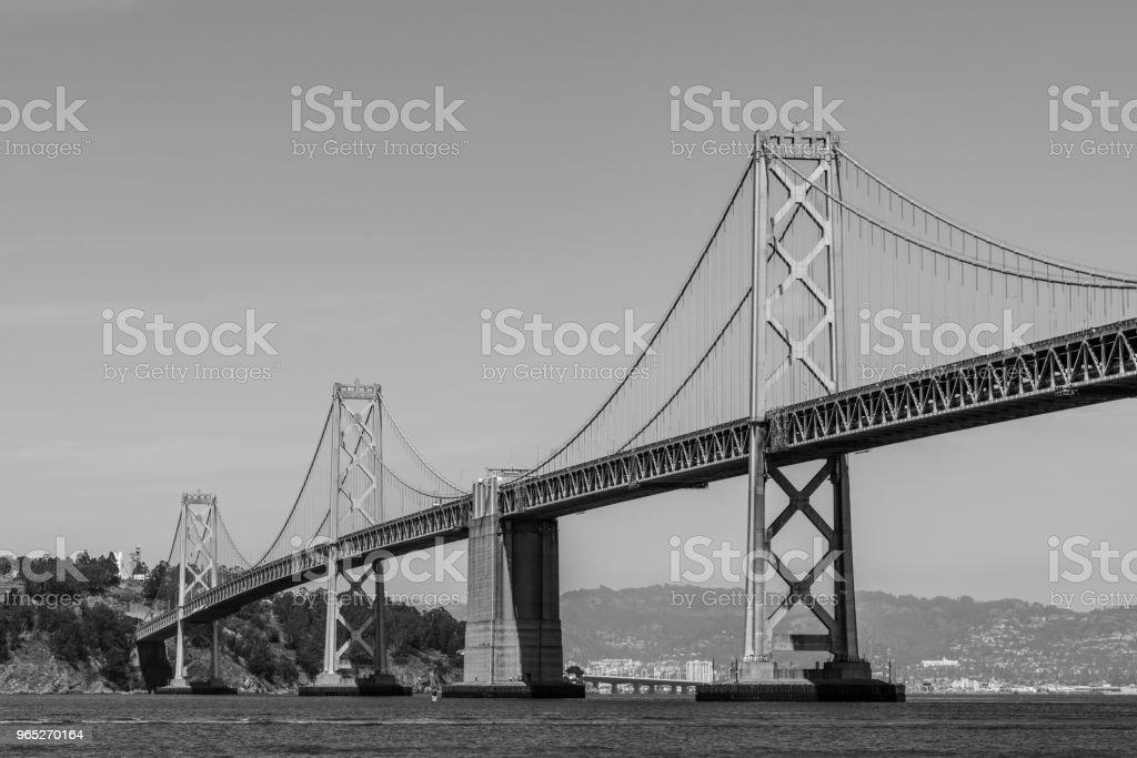 Oakland Bay Bridge to San Francisco , California Suspension bridge over the Bay Area black and white zbiór zdjęć royalty-free