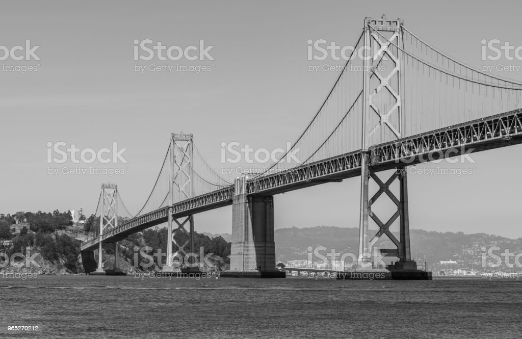 Oakland Bay Bridge to San Francisco , California Suspension bridge over the Bay Area black and white royalty-free stock photo