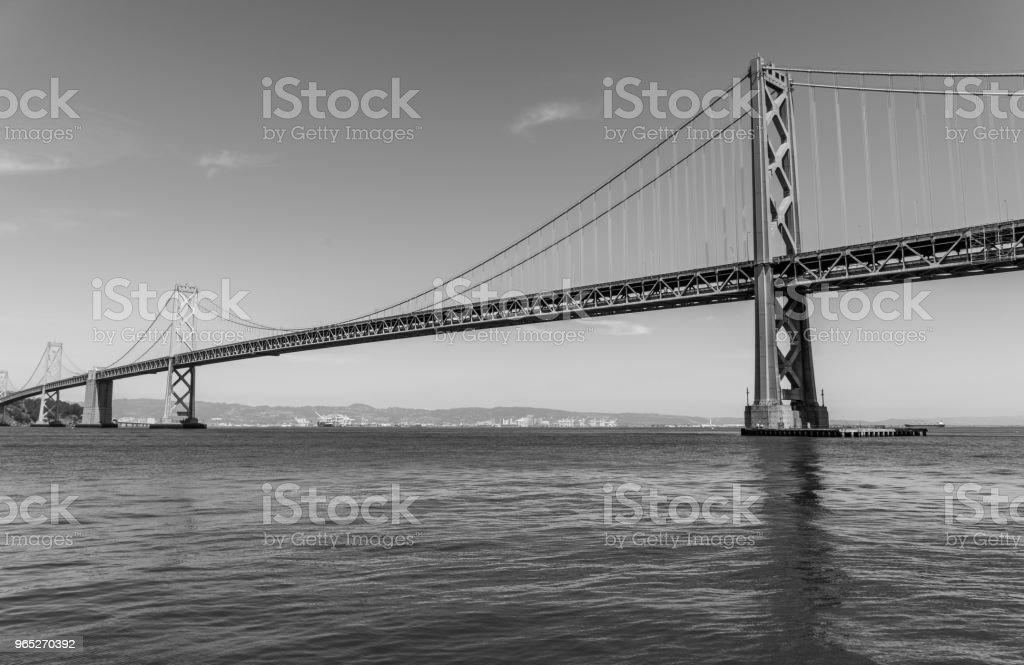 Oakland Bay Bridge to San Francisco , California Suspension bridge over the Bay Area black and white portrait zbiór zdjęć royalty-free