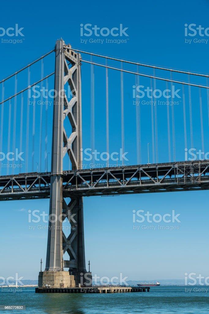 Oakland Bay Bridge to San Francisco , California Suspension bridge over the Bay Area blue sky vertical royalty-free stock photo