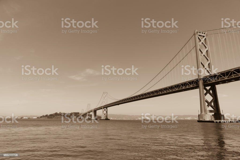Oakland Bay Bridge to San Francisco , California Suspension bridge over the Bay Area sepia toned zbiór zdjęć royalty-free