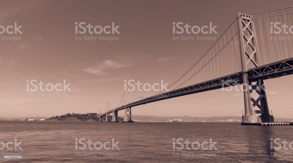 Oakland Bay Bridge to San Francisco , California Suspension bridge over the Bay Area pink toned royalty-free stock photo