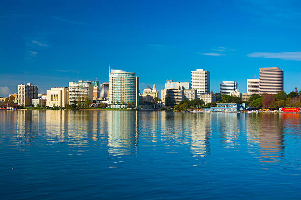 Oakland downtown skyline with reflection on Lake Merritt stock photo