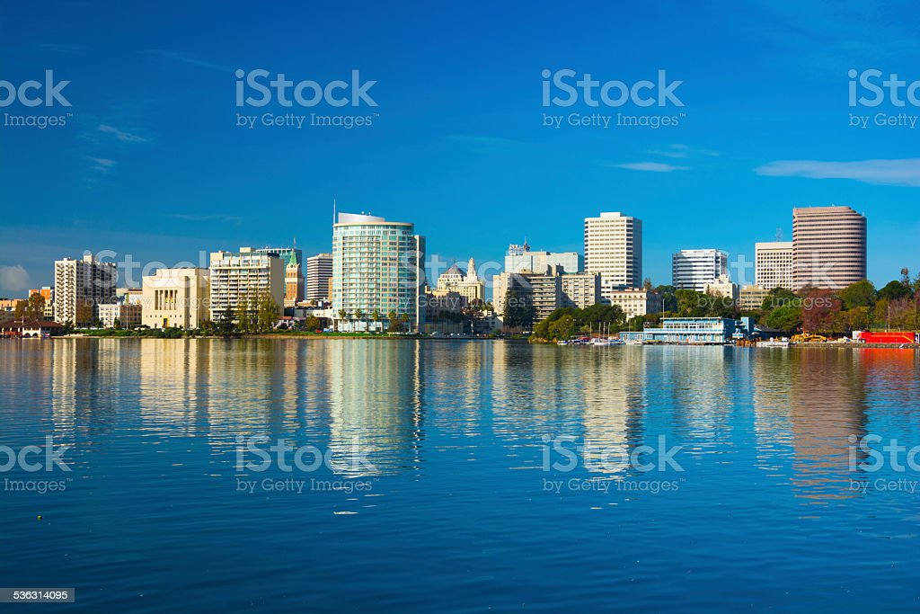 Oakland downtown skyline with reflection on Lake Merritt stock photo