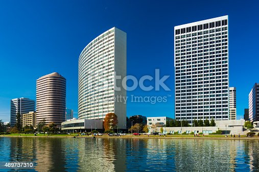 Close up views of Downtown Oakland's tallest buildings, including the Ordway building (right), and the Kaiser Center building (middle) with Lake Merritt in the foreground.