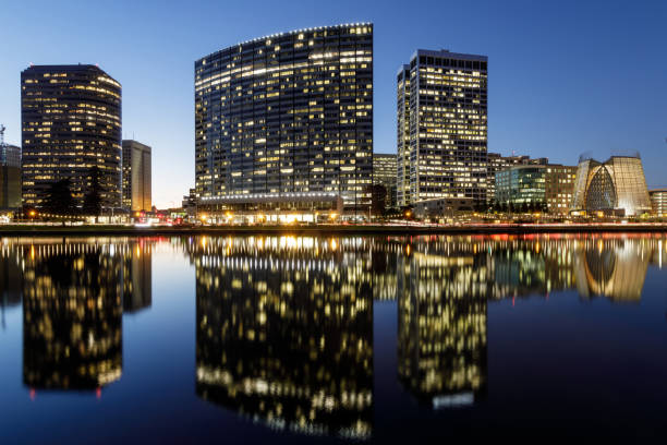 Oakland skyline panoramic view with Lake Merritt Reflections at blue hours. stock photo