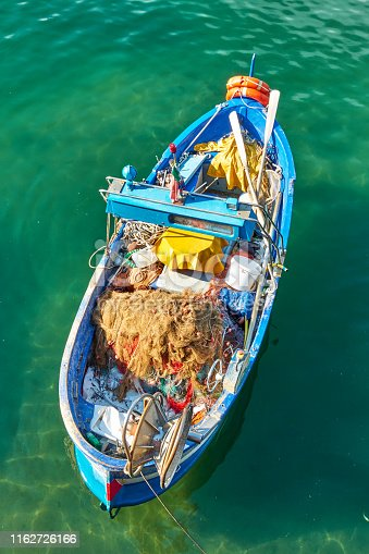 Oar fishing boat with outfit for sea fishing inside