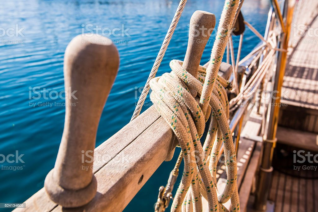 Oarlock on the boat with rope stock photo