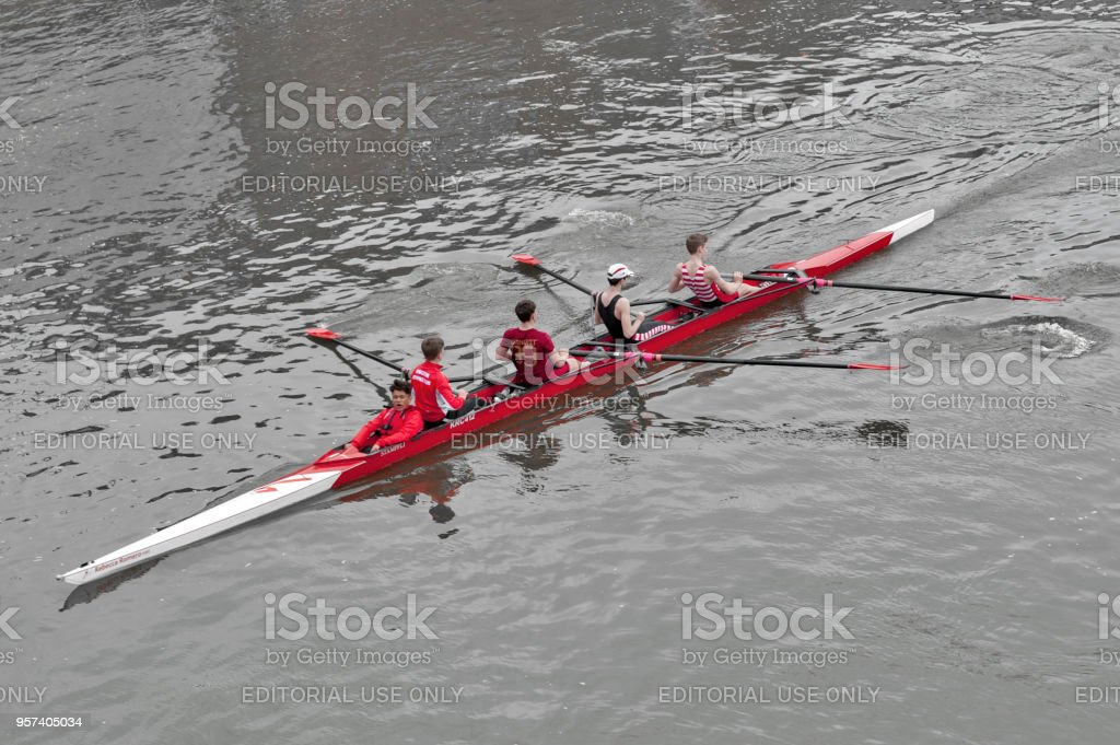 Oarsmen from Kingston Rowing Club training for canoe boat race in the River Thames, Kingston, England stock photo