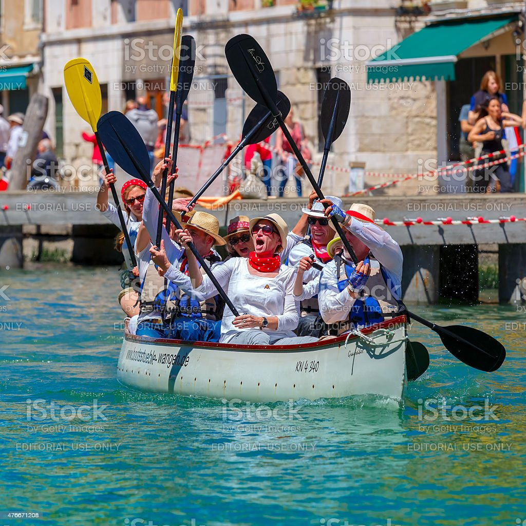 Oarsmen welcome viewers in Venice Vogalonga stock photo