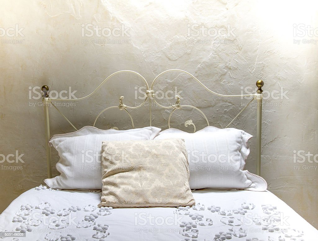 Oasis of Peace: All-White Bedroom Both Rustic and Elegant stock photo