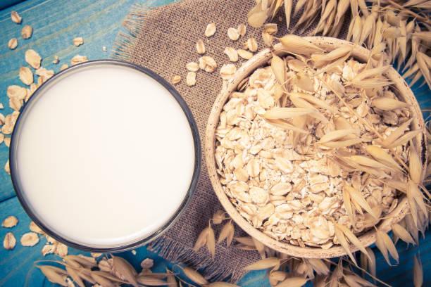 oat and oat milk. healthy breakfast, healthy eating concept. - fotos de oats imagens e fotografias de stock