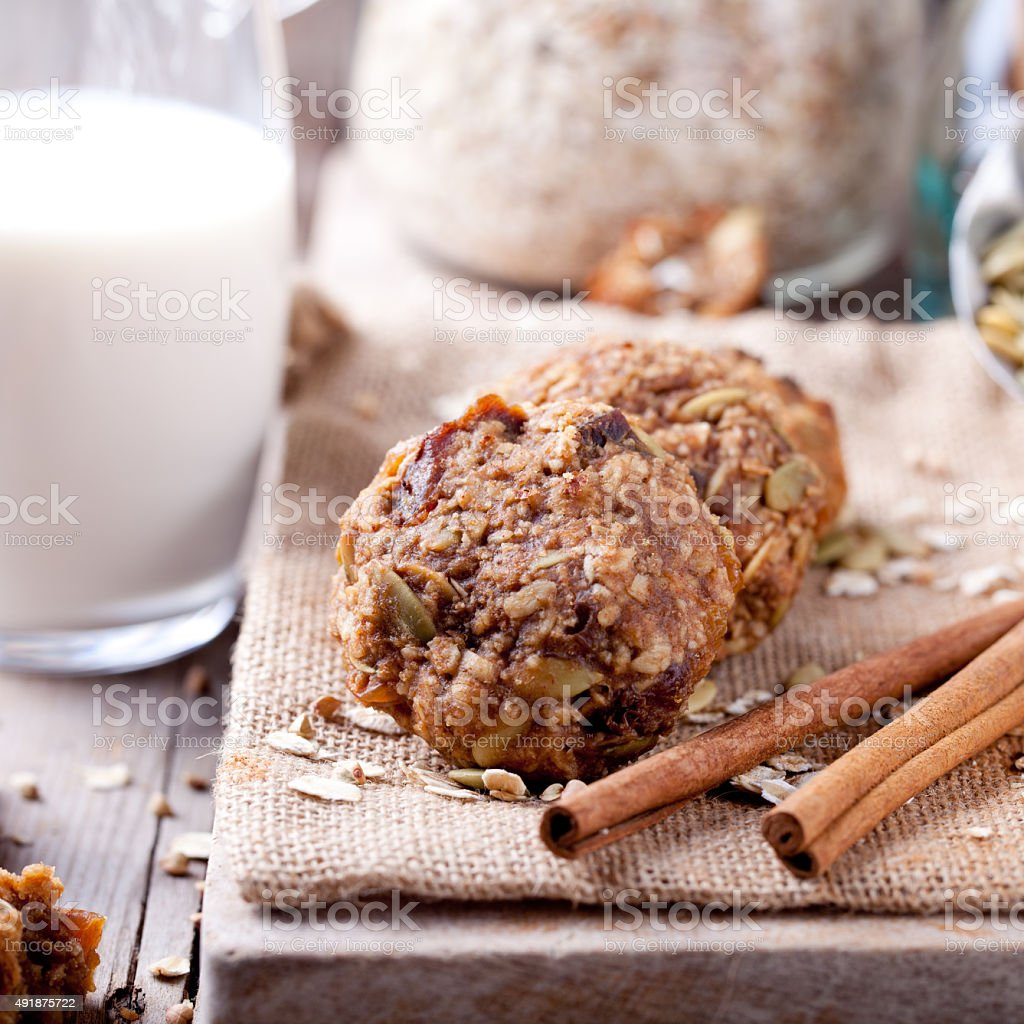 Oat and peanut butter cookies with glass of milk stock photo