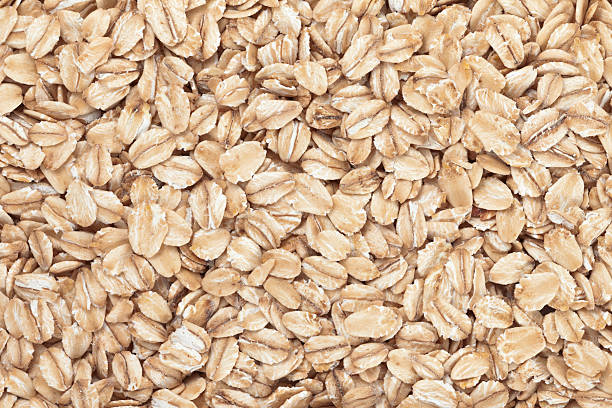 oat background - oats food stock photos and pictures
