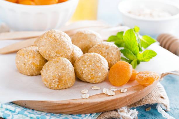 Oat balls with honey, apricot and banana, healthy vegan dessert stock photo