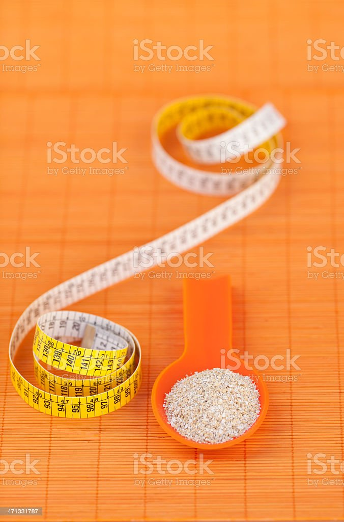 Oat bran on spoon for diet concept royalty-free stock photo