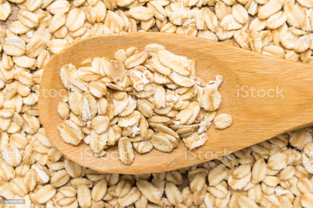 Oat cereal grain. Grains in wooden spoon. Close up. stock photo