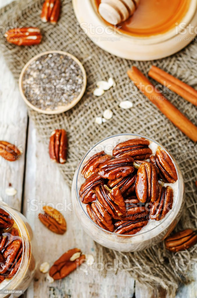 oat cinnamon Chia seed pudding with honey pecan stock photo