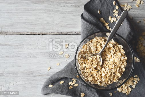 istock Oat flakes in a glass bowl on the wooden table 621114520