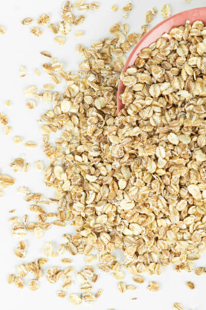 Oat flakes in bowl closeup.Top view Oat flakes in bowl closeup.Top view. Background human parainfluenza virus stock pictures, royalty-free photos & images