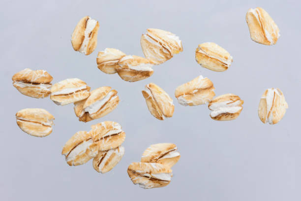 Oat flakes isolated on white background. Close up. Oat flakes isolated on white background with clipping path. Close up. oatmeal stock pictures, royalty-free photos & images